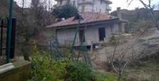 casa distrutta dalla frana